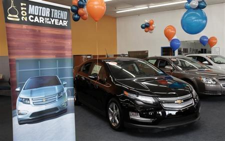 A black 2012 Chevrolet Volt electric car is seen on display in the showroom of George Matick Chevrolet auto sales in Redford, Michigan January 31, 2012. REUTERS/Rebecca Cook