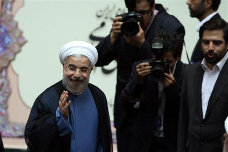 Iran's new President Hassan Rouhani (L) gestures as he arrives to his swearing-in ceremony at the Iranian Parliament in Tehran in this August 4, 2013 photo provided by the Iranian state news agency (IRNA). Picture taken August 4, 2013. REUTERS/IRNA