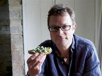 "British chef Hugh Fearnley-Whittingstall holds a bruschetta with fava beans and asparagus in this undated handout photograph reprinted with permission from his book ""River Cottage Veg""and provided by Ten Speed Press. Fearnley-Whittingstall says vegetables shouldn't get second billing to meat and fish and plays up their versatility, flavors and health benefits in his book. REUTERS/Simon Wheeler/Handout via Reuters"