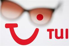 The logo of German tourism group TUI AG, owner of Europe's largest travel company TUI Travel, is pictured on a computer screen through sunglasses in this illustration picture taken in Lavigny May 20, 2012. REUTERS/Valentin Flauraud