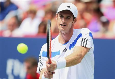 Andy Murray of Britain hits a return to Marcel Granollers of Spain at the Rogers Cup tennis tournament in Montreal, August 7, 2013. REUTERS/Christinne
