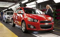 General Motors employee Peggy Burnside inspects a 2012 Chevrolet Sonic as it rolls off the assembly line at the GM Orion Assembly Plant September 14, 2011 in Lake Orion, Michigan. REUTERS/John F. Martin-General Motors/Handout
