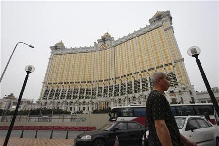 A man walks past Galaxy Macau in Macau June 13, 2013. REUTERS/Paul Yeung