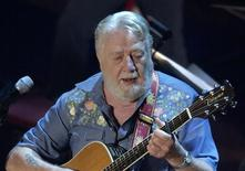 Country music artist Jack Clement sings a tribute to the late country music legend Johnny Cash, during the Cash tribute concert at the Ryman Auditorium in Nashville, Tennessee, in this November 10, 2003, file photo. REUTERS/John Sommers II/Files