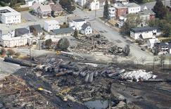 The remains of a burnt train are seen in Lac Megantic, Quebec in this July 8, 2013 file photo. REUTERS/Mathieu Belanger/Files