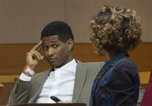 R&B singer Usher waits as he speaks with a member of his legal staff before a custody hearing at Fulton County Courthouse in Atlanta, Georgia August 9, 2013. Tameka Foster, ex-wife of Usher is seeking custody of their two young sons after one of them was hospitalized in Atlanta following a swimming pool accident this week. REUTERS/Christopher Aluka Berry