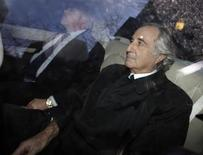 Bernard Madoff (R), who confessed to defrauding investors of 50 billion dollars, arrives home after a hearing at Federal Court, in New York, January 5, 2009. REUTERS/Chip East