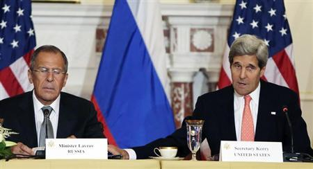United States Secretary of State John Kerry (R) and Russian Foreign Minister Sergey Lavrov attend a press briefing at the State Department in Washington before a day of talks August 9, 2013. REUTERS/Gary Cameron