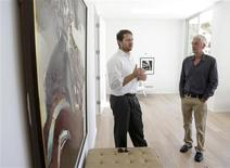 Lender Jan Brzeski (L) and developer Scott Ryan show a multi-million dollar home that was their spec renovation project in the Hollywood Hills area of Los Angeles, California August 5, 2013. REUTERS/Jason Redmond