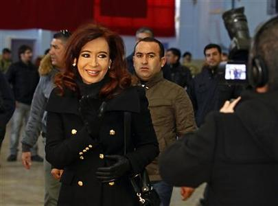 Argentine President Cristina Fernandez leaves after casting her vote at a polling station in the Patagonian city of Rio Gallegos August 11, 2013. REUTERS-Andres Arce