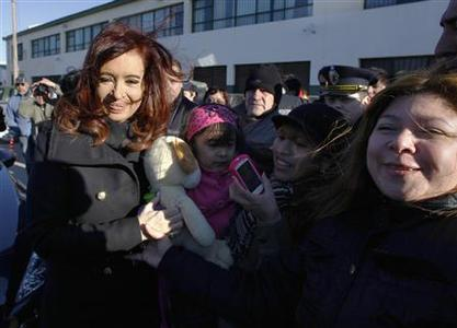 Argentine President Cristina Fernandez (L) poses with followers as she leaves after casting her vote at a polling station in the Patagonian city of Rio Gallegos August 11, 2013. REUTERS-Andres Arce