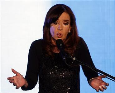 Argentine President Cristina Fernandez de Kirchner gestures as she speaks after the first results of the Congressional primary elections in Buenos Aires August 11, 2013. REUTERS-Marcos Brindicci