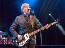 "Graham Gouldman, co-founder of pop-rock band 10cc, plays at Fairport's Cropredy Convention, in Cropredy, southern England August 9, 2013. 10cc is best known for hits such as ""I'm Not In Love"", ""Rubber Bullets"" and ""Wall Street Shuffle"" in the 1970s. REUTERS/Colin Clarke"