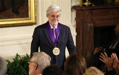 Film producer George Lucas walks to his seat after U.S. President Barack Obama awarded him the 2012 National Medal of Arts during a ceremony in the East Room of the White House in Washington July 10, 2013. REUTERS/Kevin Lamarque