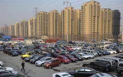 Car dealers and customers walk at a second-hand car market near a newly-built residential area in Hefei, Anhui province, January 26, 2013. REUTERS/Stringer