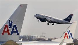 A U.S. Airways jet departs Washington's Reagan National Airport next to American Airlines jets outside Washington, in this file photo from February 25, 2013. REUTERS/Larry Downing/Files
