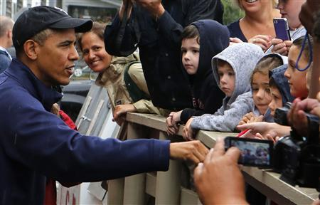 U.S. President Barack Obama talks with children outside before ordering at Nancy's restaurant at Oak Bluffs in Martha's Vineyard August 13, 2013. REUTERS/Larry Downing
