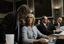 Ina Drew, (2nd L), former Chief Investment Officer of JP Morgan Chase Bank, confers with an aide before testifying before the Senate Homeland Security Investigations Subcommittee in Washington March 15, 2013. REUTERS/Gary Cameron