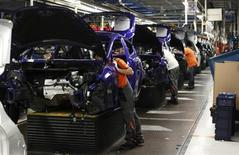 General view of the assembly line of the new Ford Fiesta in Cologne, February 4, 2013. REUTERS/Wolfgang Rattay (GERMANY - Tags: BUSINESS TRANSPORT) - RTR3F88Q