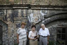 Lucija Rajner (L), Marijana Sibinovic (C) and Teodor Kovac pose for a photograph at the site where their fathers were interned in Topovske Supe, a WWII-era Nazi concentration camp for Jews, in Serbia's capital Belgrade, July 29, 2013. REUTERS/Marko Djurica