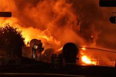 First responders fight burning train cars after a train derailment and explosion in Lac-Megantic, Quebec in this file photo taken July 6, 2013 and provided by the Transportation Safety Board of Canada. REUTERS/Transportation Safety Board of Canada/Handout