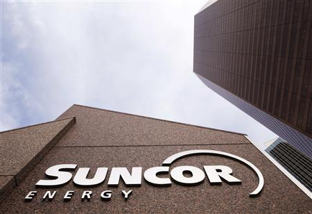 Buffett's Berkshire buys Suncor, Dish as stock bet grows