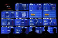 Visitors watch an electronic board showing Japan's Nikkei prices and related indexes at Tokyo Stock Exchange (TSE) in Tokyo April 24, 2013. REUTERS/Yuya Shino