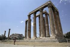 A woman visits the ancient Temple of Zeus in Athens July 2, 2013. REUTERS/John Kolesidis