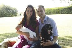 Britain's Prince William and his wife Catherine, Duchess of Cambridge, pose in the garden of the Middleton family home in Bucklebury, southern England, with their son Prince George, cocker spaniel Lupo (R) and Middleton family pet Tilly, in this undated photograph released in London August 19, 2013. REUTERS/Michael Middleton/The Duke and Duchess of Cambridge/Handout via Reuters