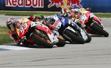 Honda MotoGP rider Marc Marquez (93) leads Yamaha rider Jorge Lorenzo (99) and Honda rider Dani Pedrosa, all of Spain, during the Indianapolis Grand Prix in Indianapolis August 18, 2013. REUTERS/Brent Smith