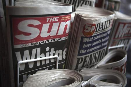 Copies of newspapers at a kiosk in London February 13, 2012. REUTERS/Finbarr O'Reilly