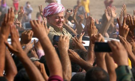 Iraqi Kurdish President Massoud Barzani (C) visits Syrian refugees at the Quru Gusik refugee camp in Arbil, about 350 km (220 miles) north of Baghdad, August 19, 2013. REUTERS/Stringer