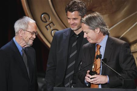 Executive producer Graham Yost and actor Timothy Olyphant (C) smile with writer Elmore Leonard (L) after receiving a Peabody award for their work in ''Justified'' during the 70th annual Peabody Awards ceremony in New York May 23, 2011. REUTERS/Lucas Jackson
