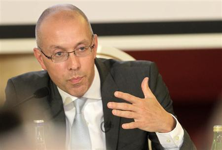 European Central Bank (ECB) executive board member Joerg Asmussen gestures as he speaks the debate ''European Economic Integration: Challenges and Opportunities'' in Vilnius July 18, 2013. REUTERS/Ints Kalnins