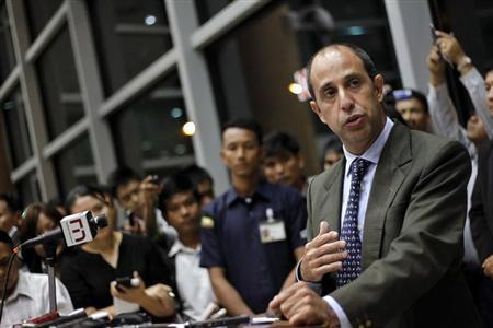 Tomas Ojea Quintana, U.N. special envoy on human rights in Myanmar, reads a statement at a news conference in Yangon International Airport February 16, 2013. REUTERS/Soe Zeya Tun