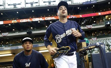 Milwaukee Brewers' Ryan Braun runs onto the field for warm ups before opening day of baseball season as the Brewers take on the Colorado Rockies in a MLB National League baseball game in Milwaukee, Wisconsin April 1, 2013. REUTERS/Darren Hauck