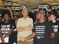 Julian Bond, former NAACP chairman (C), listens as Phillip Agnew, executive director of the Dream Defenders (R), announces an end of a 31-day sit-in at the Florida State Capitol in Tallahassee, Florida, in this file photo from August 15, 2013. REUTERS/Bill Cotterel/Files