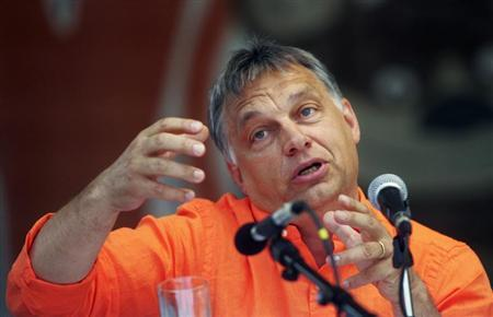 Hungary's Prime Minister Viktor Orban addresses at the Tusvanyos summer University in Baile Tusnad, 230 km (141 miles) north of Bucharest July 27, 2013. REUTERS/Mihaly Laszlo