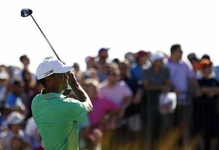 Tiger Woods of the U.S. tees off on the 15th hole during the third round of the Barclays PGA golf tournament in Jersey City, New Jersey August 24, 2013. REUTERS/Adam Hunger