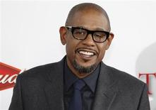 """Actor Forest Whitaker, star of the new film """"Lee Daniels' The Butler,"""" poses at the film's premiere in Los Angeles, California August 12, 2013. REUTERS/Fred Prouser"""