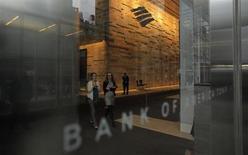 People walk at a Bank of America's Tower in New York October 24, 2012. REUTERS/Eduardo Munoz