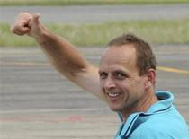Jernoc Wobert of Canada gestures to the media while arriving at Barrancabermeja airport August 27, 2013. REUTERS/Emmanuel Perez