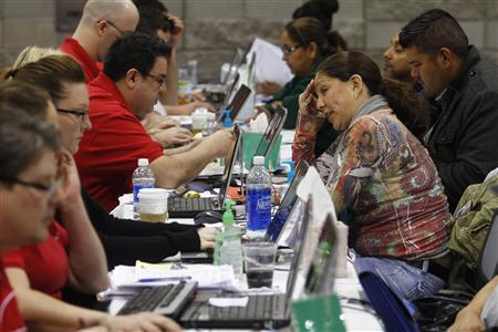Home owners speak with Bank of America representatives as they try to get home loan modifications during the Neighborhood Assistance Corporation of America event in Phoenix, February 4, 2011. REUTERS/Joshua Lott