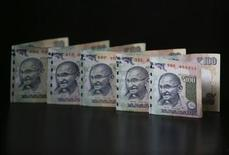 Indian Rupee notes are seen in this picture illustration taken in Mumbai June 12, 2013. REUTERS/Vivek Prakash