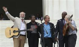 """Trayvon Martin's parents, Sybrina Fulton (2nd L) and Tracy Martin (2nd R), listen to folksingers Peter Yarrow (L) and Paul Stookey (R) during the 50th anniversary of the """"March on Washington"""" at the Lincoln Memorial in Washington August 28, 2013. Words from the first black U.S. president and bell ringing around the world on Wednesday will mark 50 years to the minute that civil rights leader Martin Luther King ended his landmark """"I have a dream"""" speech. The man at center is unidentified. REUTERS/Gary Cameron"""