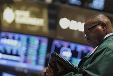 A trader works on the floor of the New York Stock Exchange August 26, 2013. REUTERS/Brendan McDermid
