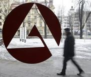 File picture shows a man walking behind the labour office sign of an unemployment centre in Munich January 29, 2009. REUTERS/Michaela Rehle/Files