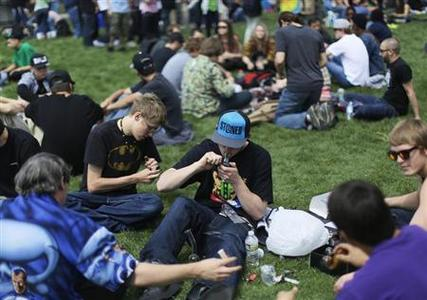 A man lights his pipe at the 4-20 pro-marijuana rally in Civic Center Park in downtown Denver April 20, 2013. REUTERS-Rick Wilking
