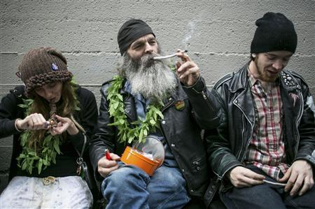 Hu Barney (C), smokes a joint during 420Fest at the Luxe Nightclub in Seattle, Washington in this file photo April 20, 2013. REUTERS-Nick Adams-Files