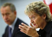 Swiss Finance Minister Eveline Widmer-Schlumpf speaks to media next to Swiss Secretary of State and government negotiator Michael Ambuehl during a news conference in Bern August 30, 2013. REUTERS/Ruben Sprich